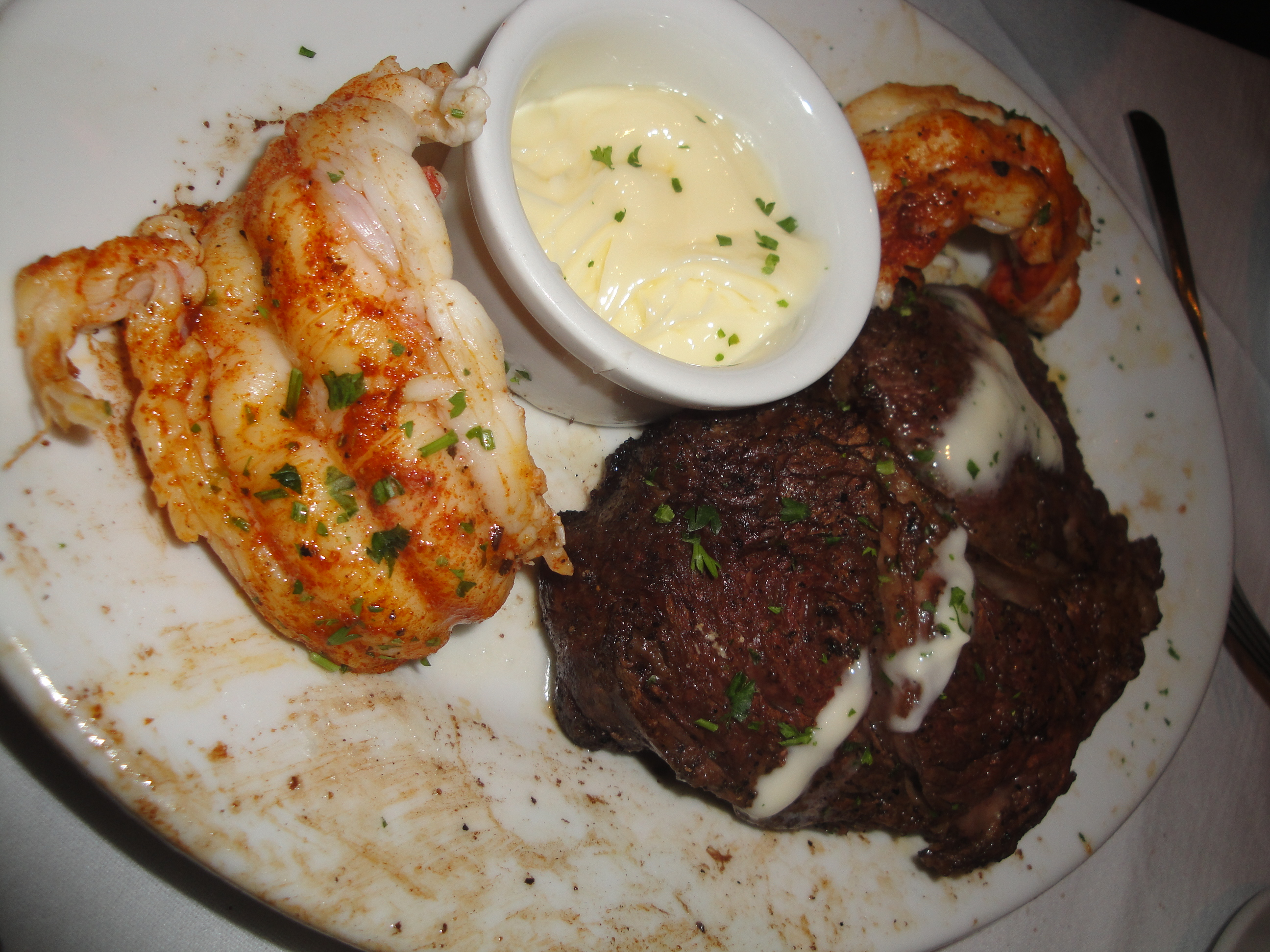 My Husband Ordered The Surf Turf Which Came With A Prime Ribeye And Two Lobster Tails Served With Lemon Butter It Was The Chef S Recommendation For The