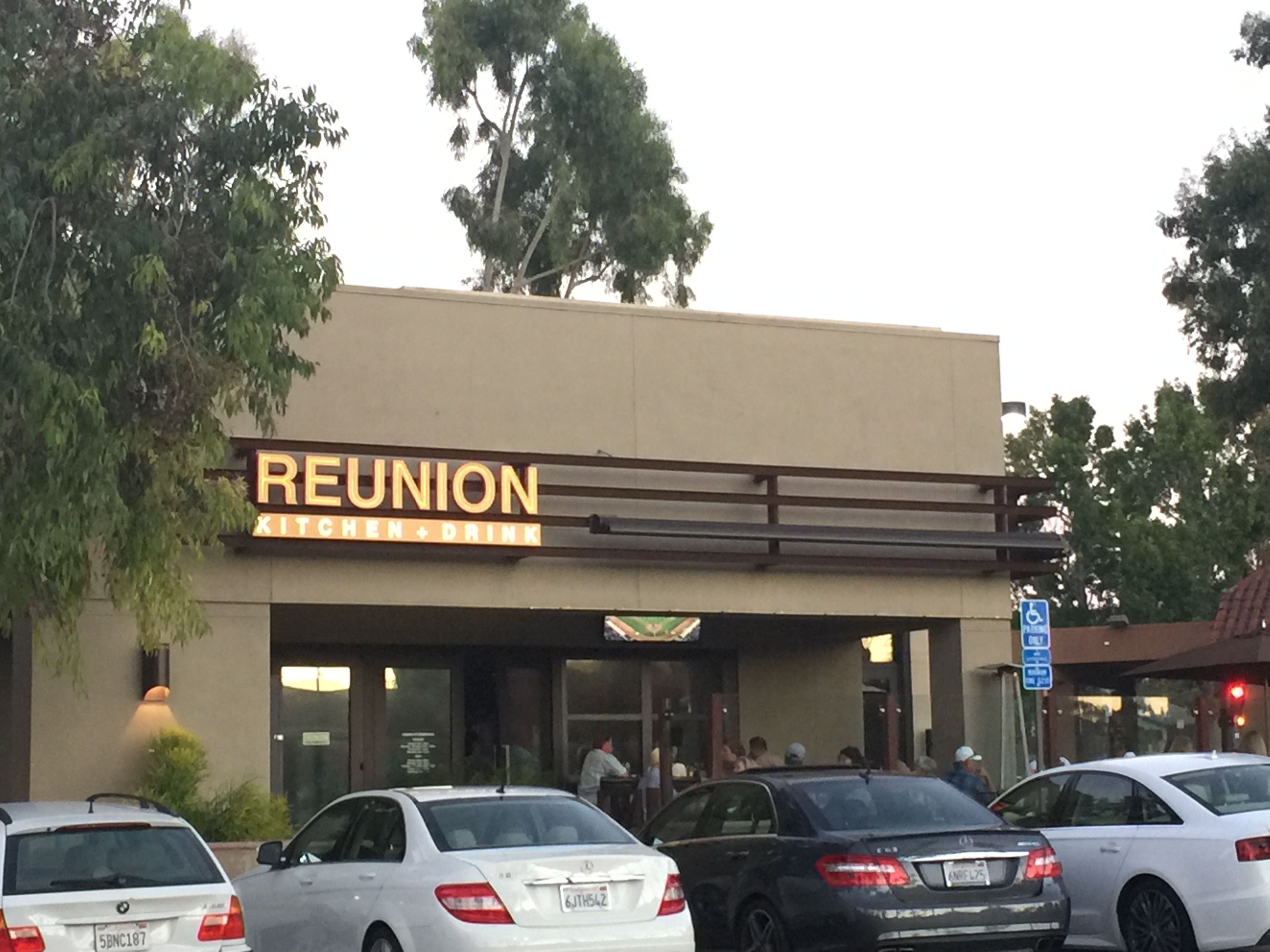 reunion kitchen drink is a full service restaurant and bar specializing in what they call modern comfort youre greeted by a full service bar in one - Reunion Kitchen